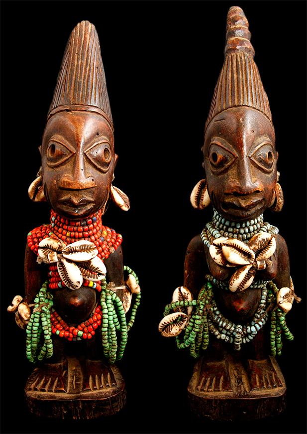 Matching Yoruba Ere Ibeji statues, signifying the death of both twins