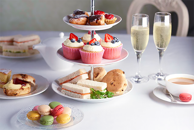 A selection of sandwiches and desserts for Afternoon Tea. Photo credit: hellengrasso.com