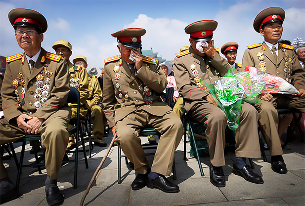 North Korean war veterans, tearing up. Photo credit: Daily Mail